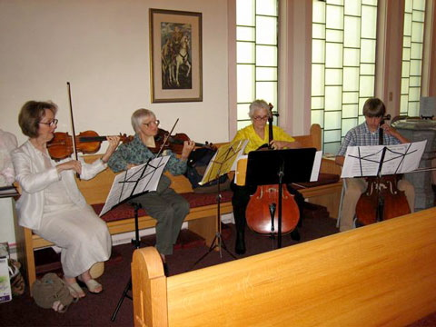 """The string quartet that played for a Sunday Eucharist this summer decided to call themselves """"The Academy of St. Martin's Across from the Golf Course."""""""